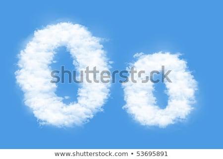 Letter O cloud font symbol. White Alphabet sign on blue sky Stock photo © popaukropa