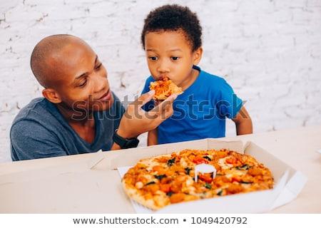 african american father feeding son Stock photo © LightFieldStudios