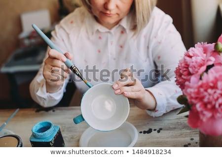 Female potter painting mug Stock photo © wavebreak_media