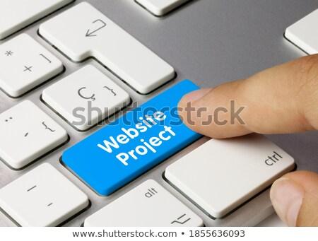 стороны пальца прессы развивающийся seo стратегия Сток-фото © tashatuvango