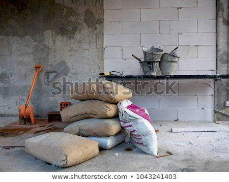 construction site of clay bricks blocks home and tools stock photo © milsiart
