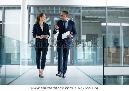 feliz · colegas · escritório · falante · outro · imagem - foto stock © wavebreak_media