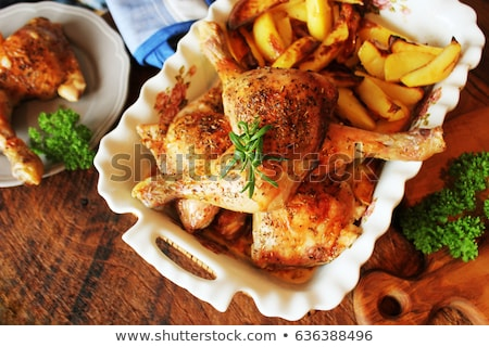 Grilled chicken leg with potato for garnish. Top view. Wooden background. Stock photo © Virgin