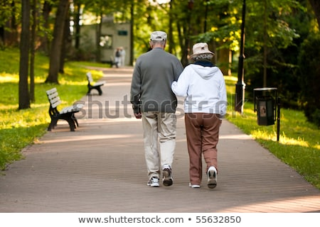 Man and woman walking down garden path Stock photo © IS2