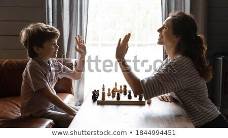 Jeune femme faible chambre échecs étage Photo stock © IS2