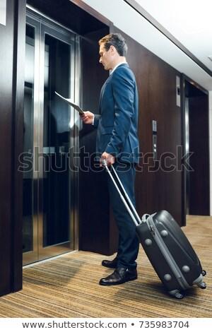 человека чтение газета лифта Сток-фото © IS2