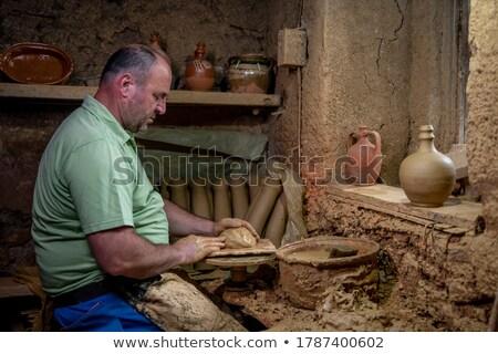 masculino · artista · argila · cerâmica · girar · roda - foto stock © boggy