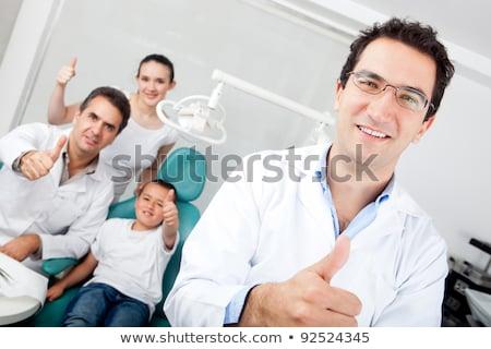 стоматолога · вызывать · знак · улыбаясь · мужчины - Сток-фото © luissantos84