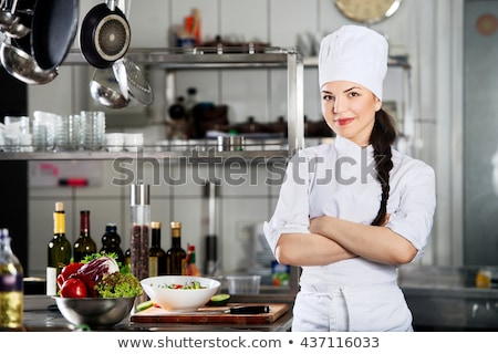 happy women and chef cook with menu in kitchen Stock photo © dolgachov