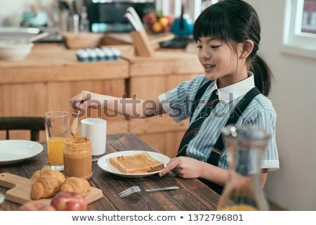 glückliche · Familie · zwei · Kinder · Frühstück · Essen · Familie - stock foto © choreograph