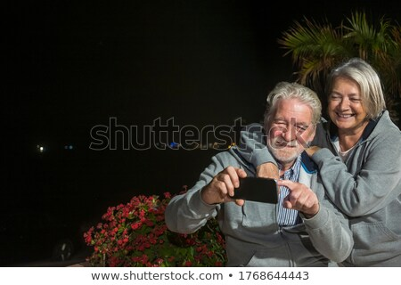 attractive casual man sitting and holding palms together stock photo © feedough
