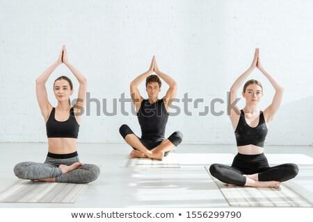 Nő gyakorol jóga póz testmozgás energia Stock fotó © boggy