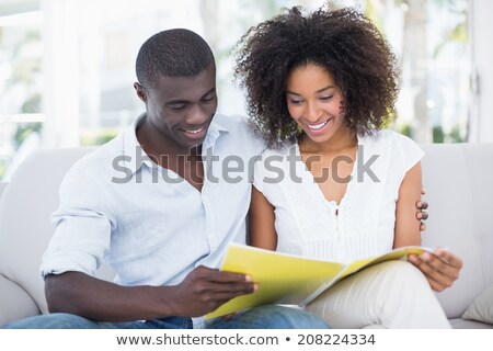 Jeunes africaine couple regarder souriant Photo stock © AndreyPopov