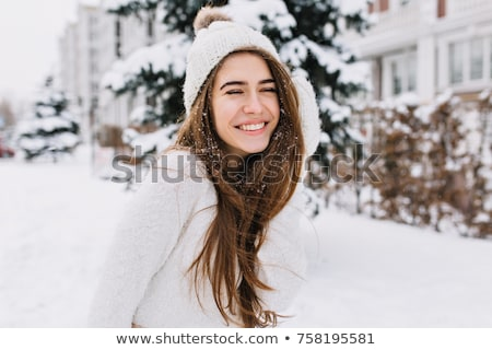 Сток-фото: красивая · девушка · весело · улице · зима · красный · свитер