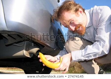 Banán kipufogó férfi autó cső város Stock fotó © vladacanon