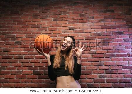 Portre enerjik kız 20s ayakta tuğla duvar Stok fotoğraf © deandrobot