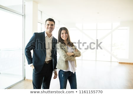 couple in business suits standing together with crossed arms Stock photo © feedough