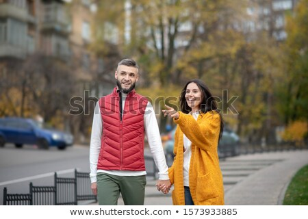 woman looking at her boyfriend pointing at something stock photo © kzenon