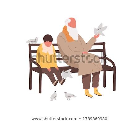 Man Sitting with Bird in Autumn Fall Season Park Stock photo © robuart
