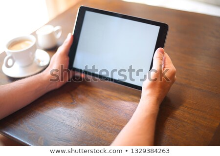 man with tablet computer reading news at tablet coputer stock photo © dashapetrenko