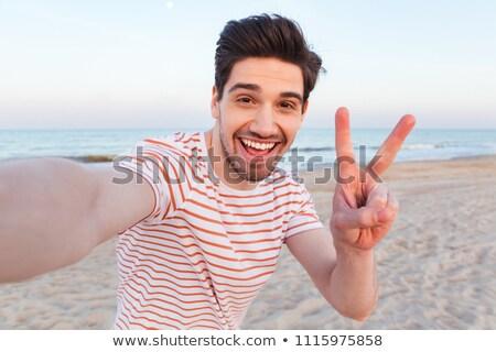 A man makes selfie on the background of the sea Photo stock © galitskaya