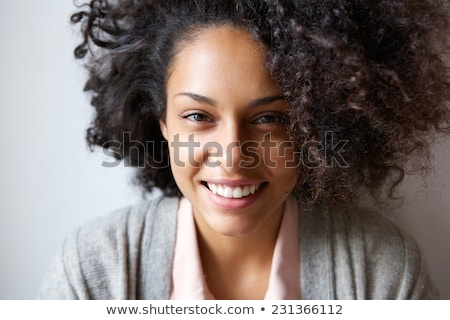 Közelkép portré mosolyog fiatal lány göndör haj másfelé néz Stock fotó © deandrobot