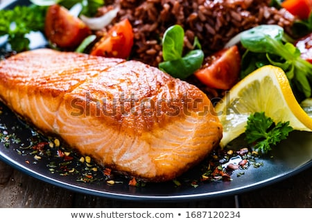 Baked salmon fillet with vegetables stock photo © furmanphoto