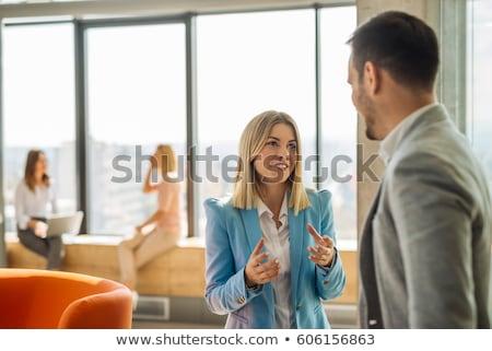 Uomini d'affari parlando sorridere ritratto uomo lavoro Foto d'archivio © szefei