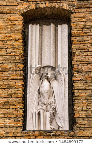 Eagle, symbol of John the Evangelist, on the facade of  Abbey of Stock photo © boggy