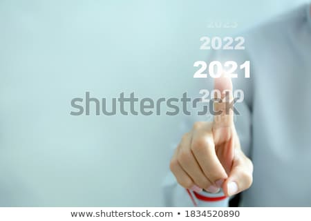 Happy businessman pointing finger at blank card. Stock photo © lichtmeister