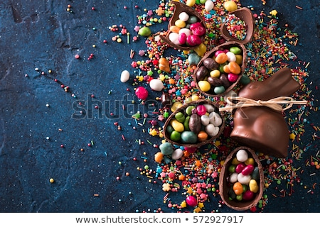 Stock photo: chocolate eggs, easter bunny and candies on wood