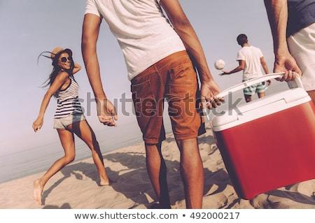 Hátsó nézet többnemzetiségű barátok megnyugtató sétál tengerpart Stock fotó © wavebreak_media