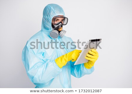 man wearing hazmat suit protective gas mask and goggles reachin stock photo © feverpitch
