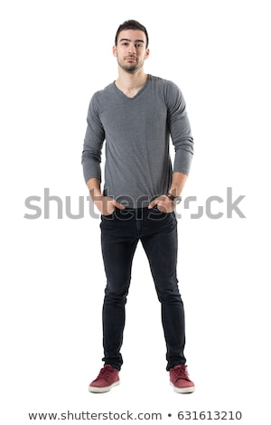 Portrait of unshaven young man posing on camera with hands in pockets Stock photo © deandrobot