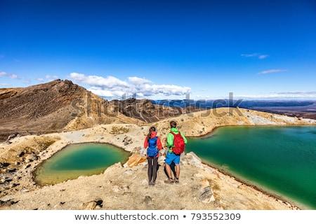 New Zealand Hiking Couple Backpackers Tramping At Tongariro National Park. Male and female hikers hi Stock photo © Maridav