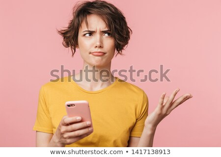 Displeased young woman posing isolated Stock photo © deandrobot