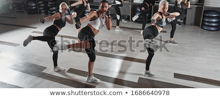 Girl training body combat Stock photo © pedromonteiro