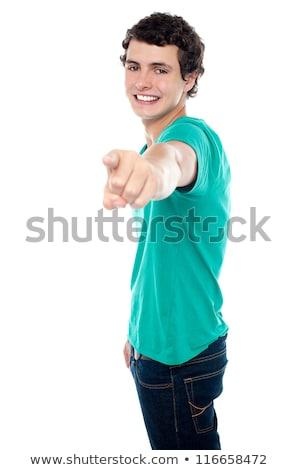 左に指を向けるトレンディな少年 ストックフォト © stockyimages