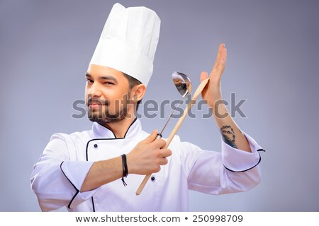 Funny young chef with a knife in kitchen  Stock photo © vladacanon