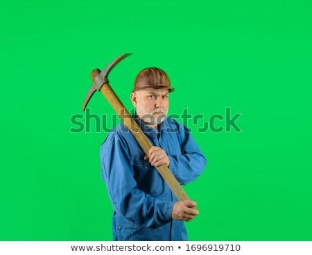 Tradesman holding a pickax Stock photo © photography33