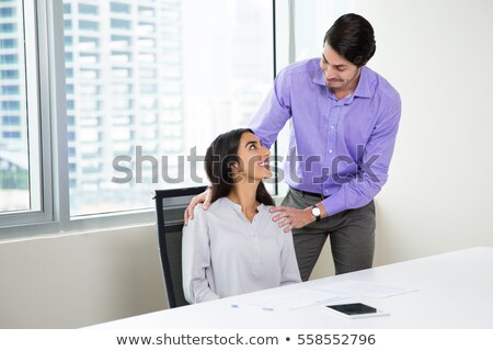 Women touching the shoulder of a man Stock photo © photography33