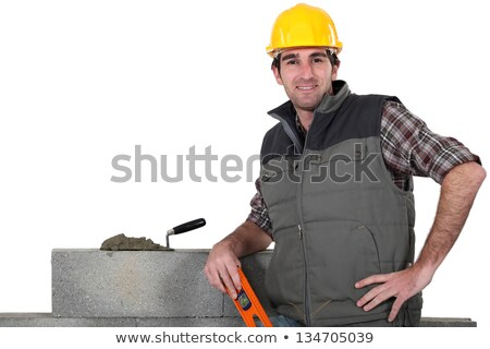bricklayer posing near wall with arm akimbo Stock photo © photography33