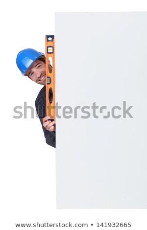 Happy artisan holding spirit-level Stock photo © photography33