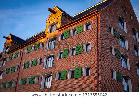 Hotel facade with golden shutters Stock photo © elxeneize
