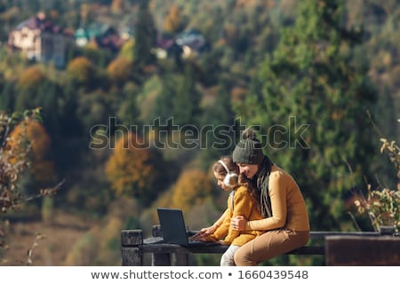 Mother and daughter with laptop Stock photo © photography33