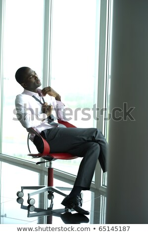 Stressed office worker loosening his tie Stock photo © photography33