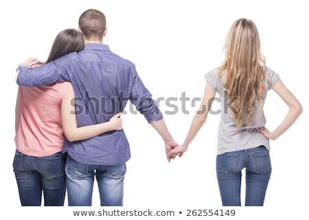 Uomo fidanzata holding hands un altro donna vista posteriore Foto d'archivio © wavebreak_media
