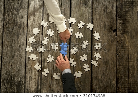 White jigsaw puzzle pieces scattered on wooden table Stock photo © stevanovicigor