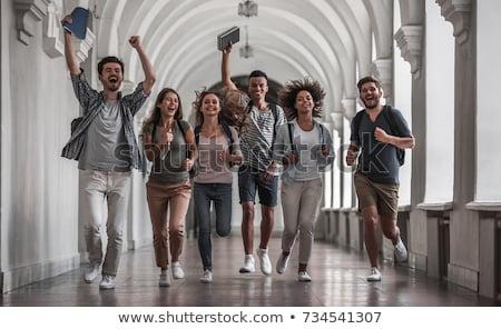 University student running with holding books and smiling Stock photo © imagedb