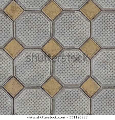 Tiles Laid out of Large Gray Polygons and Small Yellow Squares in the Corners. Stock photo © tashatuvango